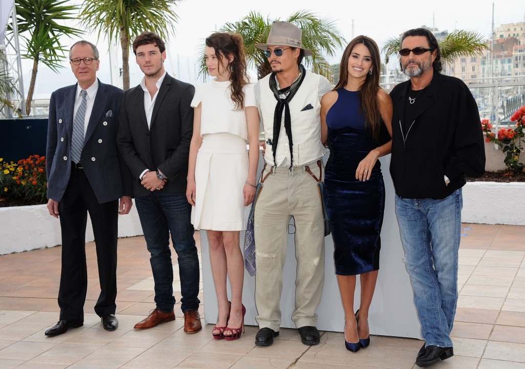 """Geoffrey Rush; Sam Caflin; Astrid Berges-Frisbey; Johnny Depp; Penelope Cruz; Ian McShane attend the """"Pirates of the Caribbean: On Stranger Tides"""" photocall at the Palais des Festivals during the 64th Cannes Film Festival on May 14, 2011 in Cannes, France."""