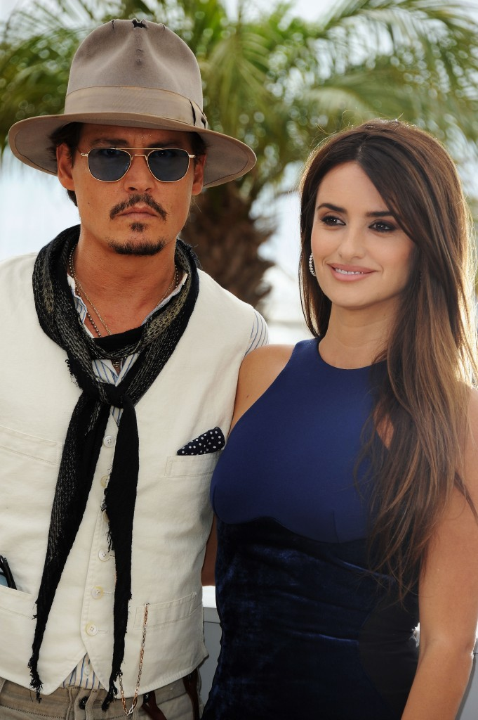 """Johnny Depp and Penelope Cruz attends the """"Pirates of the Caribbean: On Stranger Tides"""" photocall at the Palais des Festivals during the 64th Cannes Film Festival on May 14, 2011 in Cannes, France."""